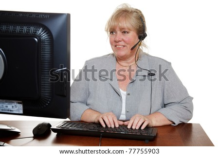Mature customer service representative with headset - stock photo