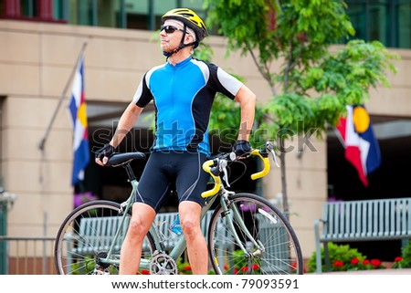 Mature cyclist in downtown - stock photo