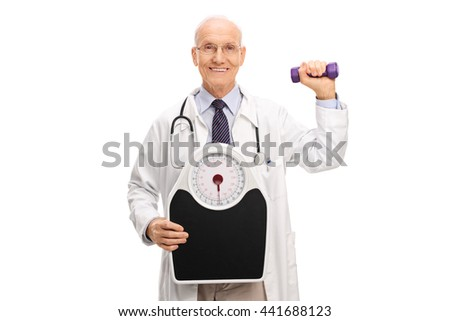 Mature doctor holding a weight scale and a dumbbell isolated on white background - stock photo