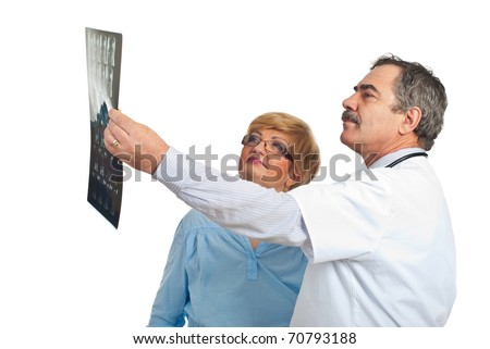 Mature doctor man showing to his patient woman the results of MRI and discussing together isolated on white background - stock photo