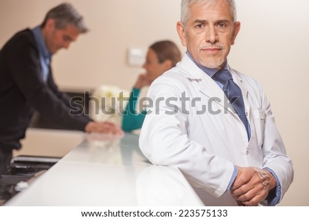 Mature doctor showing confidence and safeness. - stock photo