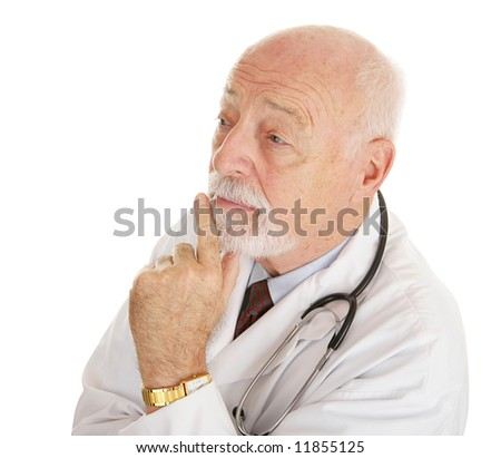 Mature, experienced doctor lost in thought.  Isolated on white. - stock photo