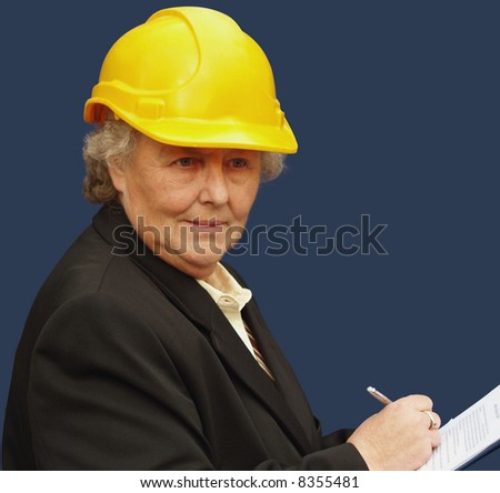 Mature female executive taking stock of a project - stock photo
