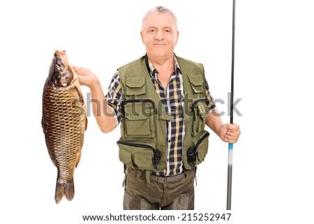 Mature fisherman holding big fish and fishing rod isolated on white background - stock photo