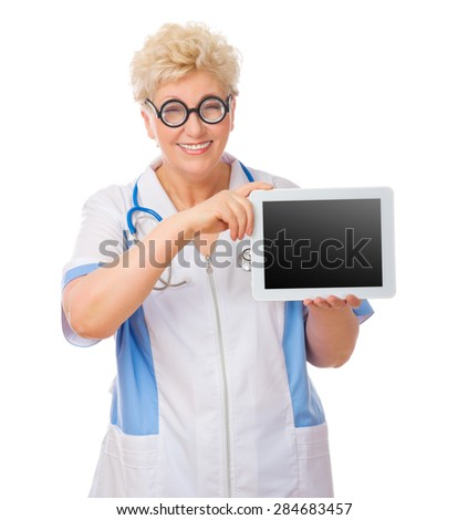 Mature funny doctor with tablet PC isolated - stock photo
