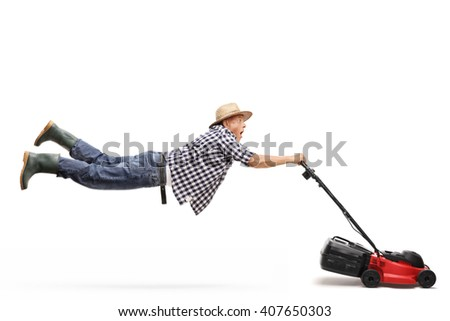 Mature gardener being pulled by a powerful lawn-mower isolated on white background - stock photo
