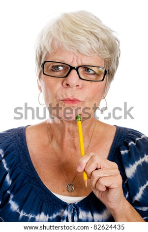 Mature gray haired woman struggling to remember something. - stock photo