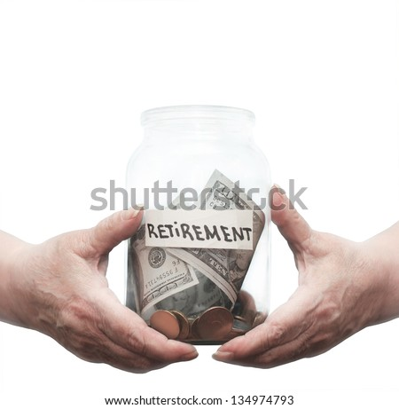 Mature hands holding a glass jar with money on the pension - stock photo