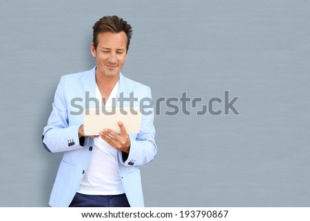 Mature handsome guy with tablet, isolated - stock photo