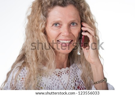 Mature Hippie female woman on cellphone expression - stock photo