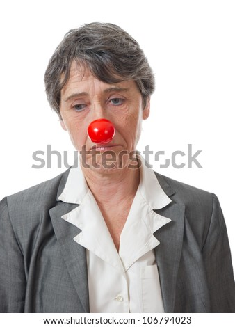 mature lady with red nose looking down on white background - stock photo