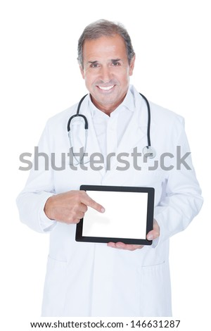 Mature Male Doctor Holding Digital Tablet On White Background - stock photo