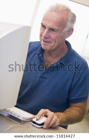 Mature male student learning computer skills - stock photo