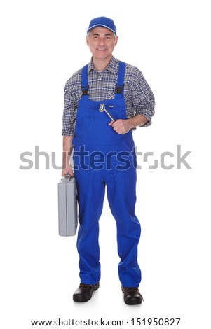Mature Male Technician Holding Worktool Over White Background - stock photo