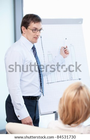 Mature man about the schedule at the office - stock photo