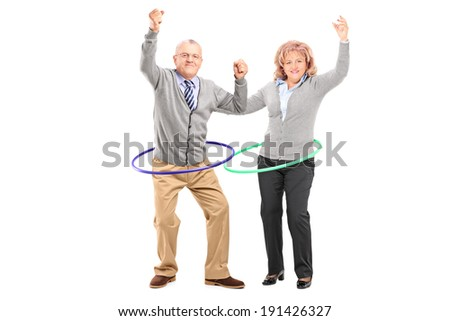Mature man and woman exercising with hula hoop isolated on white background - stock photo