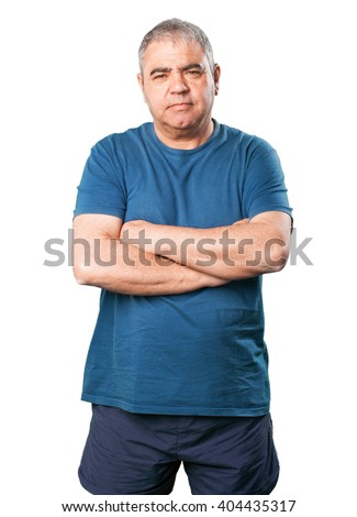 mature man crossing arms - stock photo