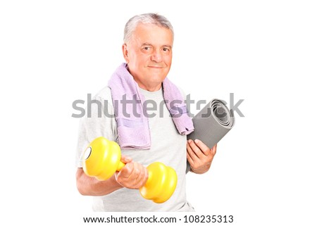 Mature man holding weight and mat, isolated on white background - stock photo