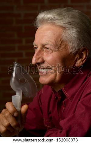 mature man in a shirt on a brick background - stock photo