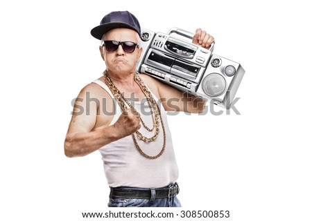 Mature man in hip-hop outfit holding a ghetto blaster and looking at the camera isolated on white background - stock photo