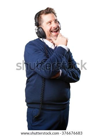 mature man listening to music - stock photo