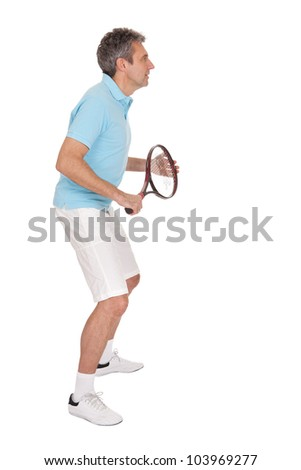 Mature man playing tennis. Isolated on white - stock photo