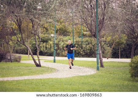 Mature man running at the city park - stock photo