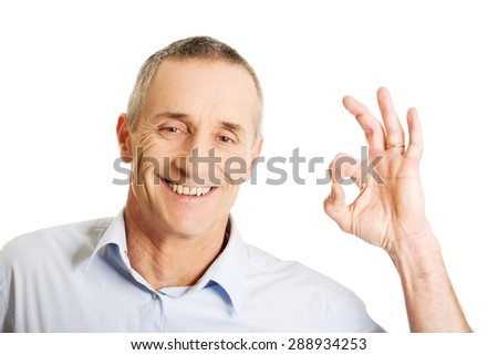Mature man showing perfect sign. - stock photo