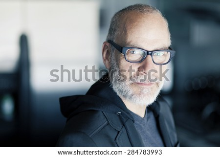 Mature Man Smiling At The Camera - stock photo