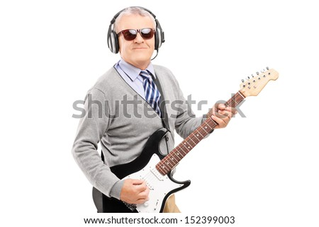 Mature man with glasses playing guitar isolated on white background - stock photo