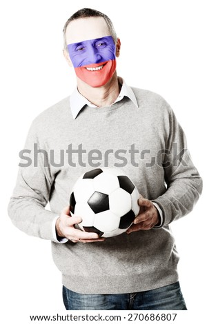Mature man with Russia flag painted on face. - stock photo