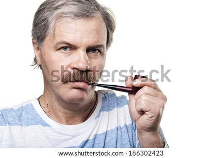 mature man with smoking pipe isolated on white background - stock photo