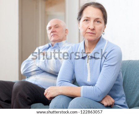 Mature married couple having quarrel at home - stock photo