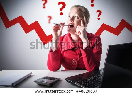 Mature, middle aged woman having questions about money and finance. Business woman in red clothes worried about her income, paycheck and credit. How to invest your capital concept. - stock photo
