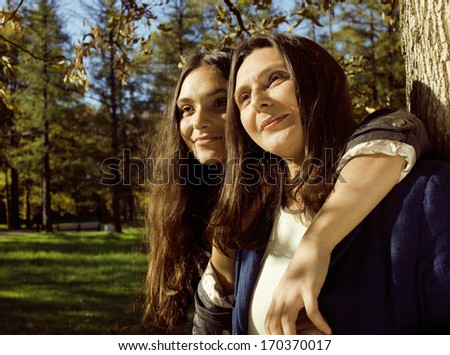 mature mother with daughter outside - stock photo