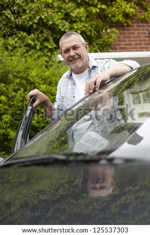 Mature Motorist Standing Next To Car - stock photo
