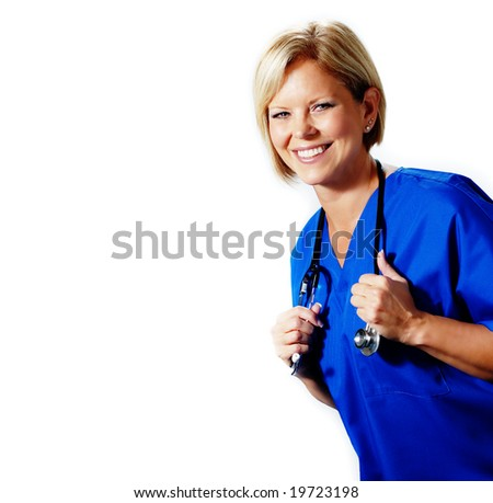 Mature nurse in blue scrubs with stethoscope. - stock photo