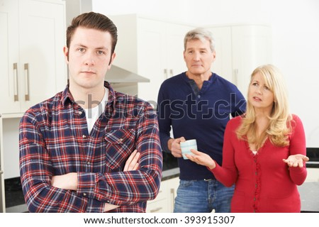 Mature Parents Frustrated With Adult Son Living At Home - stock photo