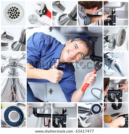 Mature plumber fixing a sink at kitchen - stock photo