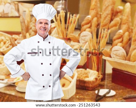 Mature professional chef man in modern restaurant. - stock photo