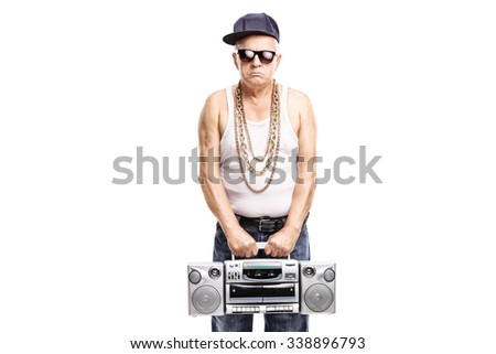 Mature rapper holding a ghetto blaster and looking at the camera isolated on white background - stock photo