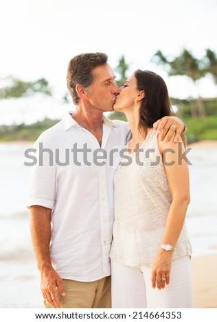 Mature Retired Couple Enjoying Tropical Sunset Beach Vacation - stock photo