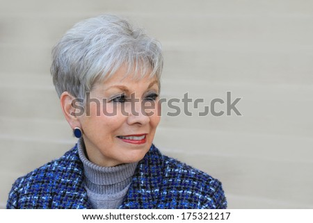 Mature Retired Professional Business Woman Smiling Looking to the Side Copy Space CEO - stock photo