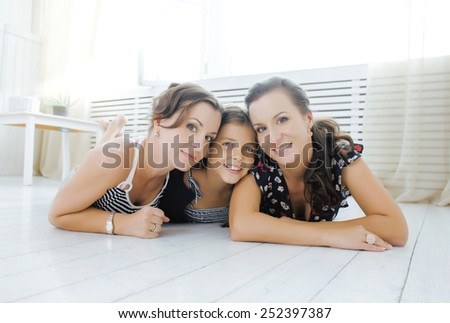 Mature sisters twins at home with little daughter, happy family smiling cheerful - stock photo