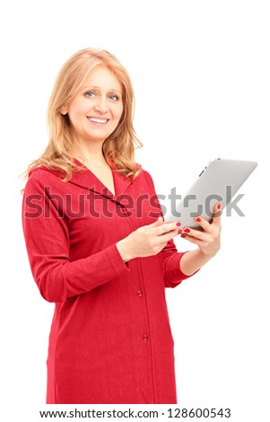 Mature smiling woman holding a tablet and looking at camera isolated on white background - stock photo