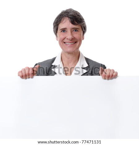 mature smiling woman holding white board isolated on white background - stock photo