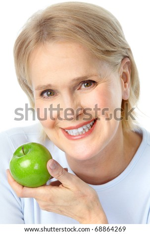 Mature smiling woman with a green apple - stock photo