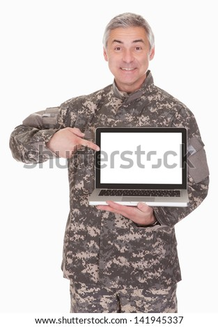 Mature Soldier Showing Laptop Isolated On White Background - stock photo