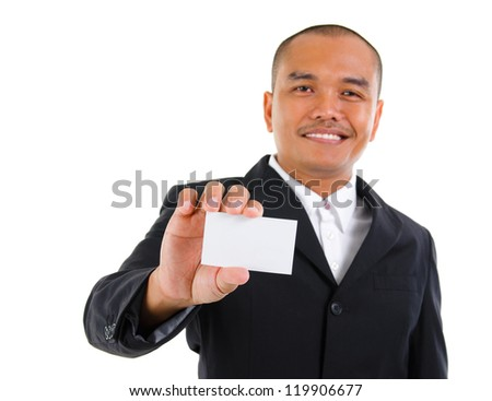 Mature Southeast Asian businessman holding business card, focus on hand over white background - stock photo