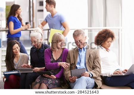 Mature Students On Further Education Course - stock photo